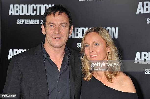 "Actor Jason Isaacs and wife Emma Hewitt arrive at The World premiere of ""Abduction"" held at Grauman's Chinese Theater in Hollywood."