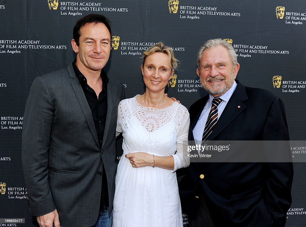 Actor Jason Isaacs, his wife Emma and BAFTA LA Chairman Gary Dartnall arrive at the 26th Annual BAFTA LA Garden Party at the British Consul-General's official residence on June 2, 2013 in Los Angeles, California.