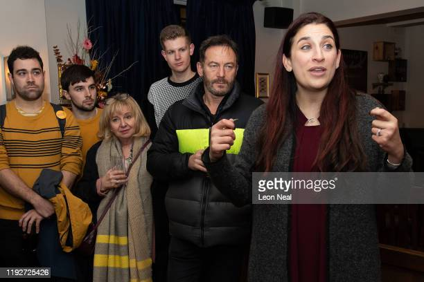 Actor, Jason Isaacs looks on as Lib Dem MP, Luciana Berger speaks to supporters during a Liberal Democrat campaign event at The Bald Faced Stag Pub...
