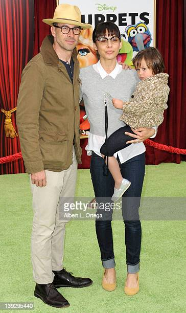 Actor Jason Lee and actress Ceren Alkac with daughter arrive for The Muppets Los Angeles Premiere held at the El Capitan Theatre on November 12 2011...