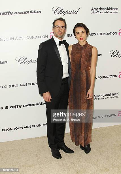 Actor Jason Lee and Ceren Alkac arrive at the 19th Annual Elton John AIDS Foundation's Oscar viewing party held at the Pacific Design Center on...