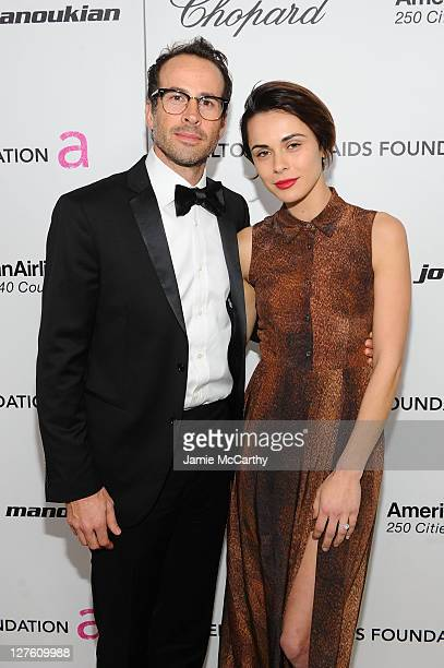Actor Jason Lee and Ceren Alkac attend the 19th Annual Elton John AIDS Foundation Academy Awards Viewing Party at the Pacific Design Center on...