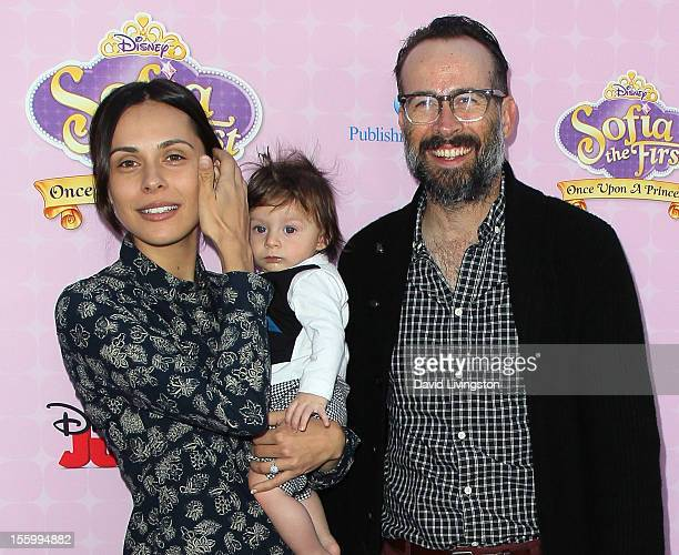 Actor Jason Lee poses with wife Ceren Alkac and son Sonny at the premiere of Disney Channels' Sofia The First Once Upon a Princess at Walt Disney...