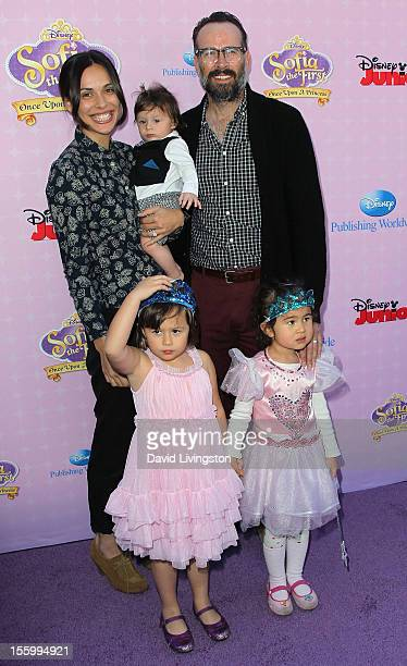 Actor Jason Lee with wife Ceren Alkac holding son Sonny pose at the premiere of Disney Channels' Sofia The First Once Upon a Princess at Walt Disney...