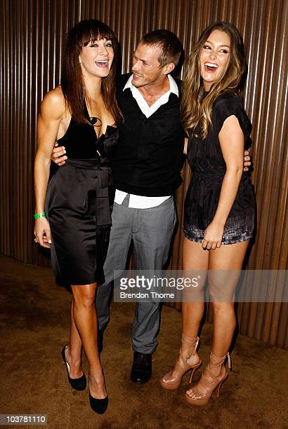 Actor Jason Lewis from 'Sex and the City' poses with Michelle Bridges and Erin McNaught during the promotion of the new Xbox 360 Kinect...