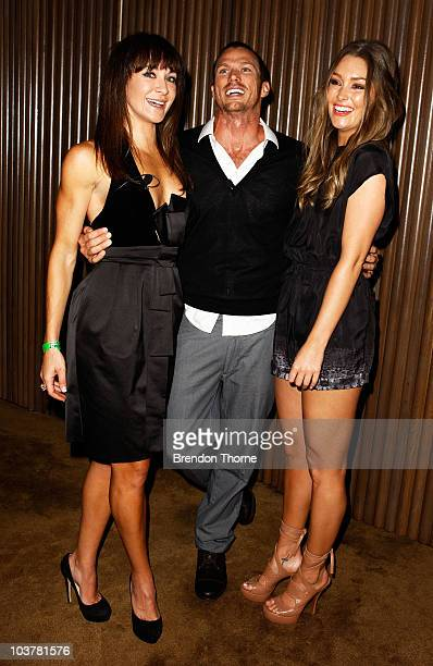 Actor Jason Lewis from Sex and the City poses with Michelle Bridges and Erin McNaught during the promotion of the new Xbox 360 Kinect controllerfree...