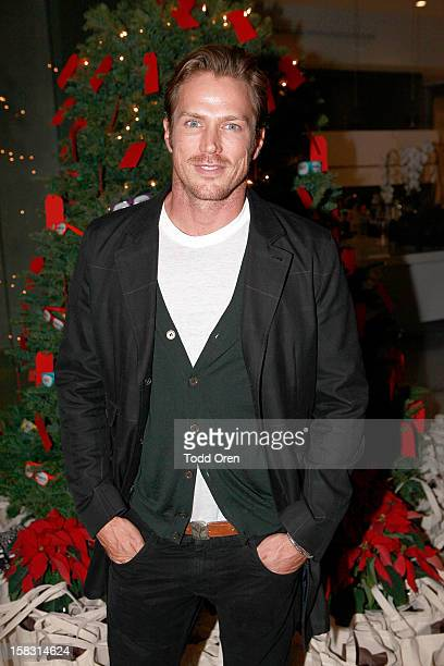 Actor Jason Lewis poses at the Hukkster Holiday Party at a Private Residence on December 12 2012 in Los Angeles California