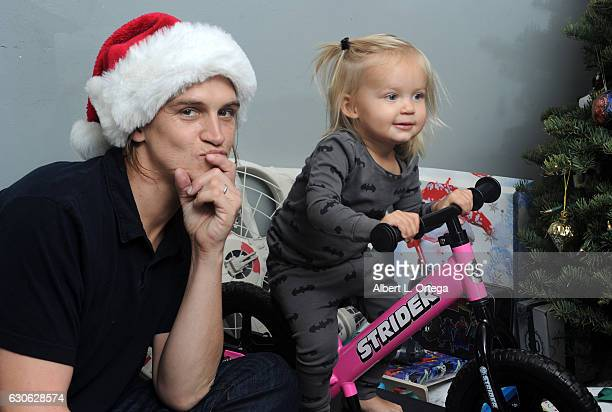 Actor Jason Mewes of Jay and Silent Bob poses with his daughter Logan and wife Jordan Monsanto in front of the Christmas Tree in Los Angeles on...