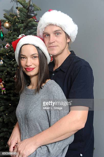 Actor Jason Mewes of Jay and Silent Bob poses with his wife Jordan Monsanto in front of the Christmas Tree in Los Angeles on December 26 2016 in Los...