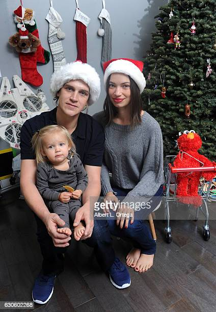 Actor Jason Mewes of 'Jay Silent Bob' poses with his wife Jordan Monsanto and daughter Logan in front of their Christmas Tree on December 27 2016 in...