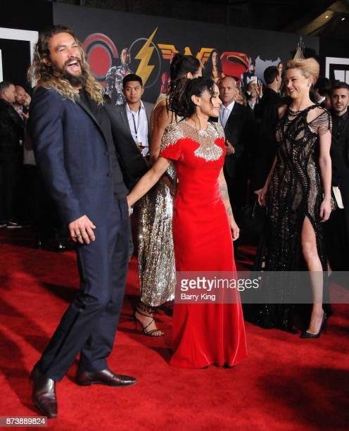 Actor Jason Momoa actresses Lisa Bonet Gal Gadot and Amber Heard attend the premiere of Warner Bros Pictures' 'Justice League' at Dolby Theatre on...