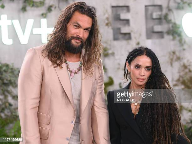 US actor Jason Momoa and his wife US actress Lisa Bonet arrive for Apple TV world premiere of SEE at the Fox Regency Village Theater in Los Angeles...