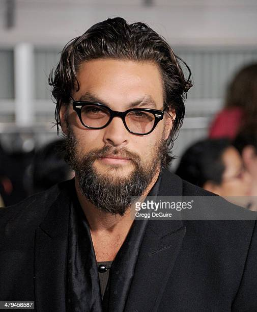 Actor Jason Momoa arrives at the Los Angeles premiere of 'Divergent' at Regency Bruin Theatre on March 18 2014 in Los Angeles California