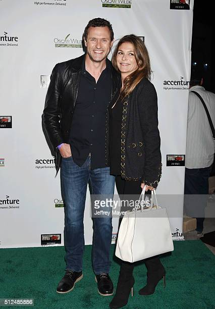 Actor Jason O'Mara and actress Paige Turco arrive at the 2016 Oscar Wilde Awards at Bad Robot on February 25 2016 in Santa Monica California