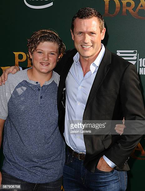 Actor Jason O'Mara and son David O'Mara attend the premiere of Pete's Dragon at the El Capitan Theatre on August 8 2016 in Hollywood California