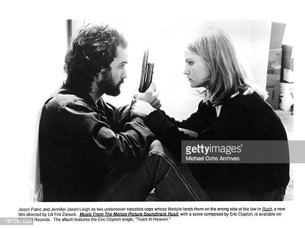 Actor Jason Patric and actress Jennifer Jason Leigh on set of the movie Rush in 1991