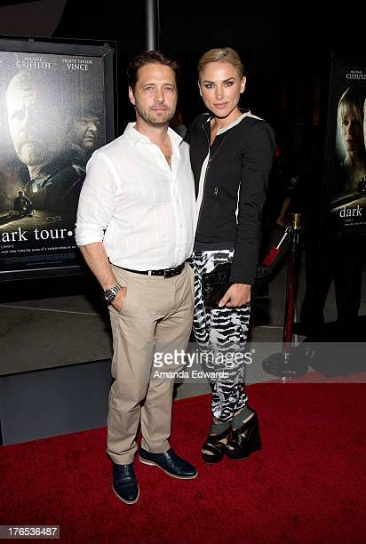 Actor Jason Priestley and his wife Naomi LowdePriestley arrive at the premiere of Dark Tourist at ArcLight Hollywood on August 14 2013 in Hollywood...