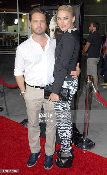 Actor Jason Priestley and his wife Naomi LowdePriestley attend the premiere of 'Dark Tourist' at ArcLight Hollywood on August 14 2013 in Hollywood...
