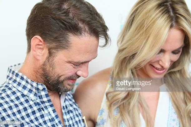 Actor Jason Priestley and Naomi LowdePriestley arrive at Raising The Bar To End Parkinson's at Laurel Point on July 27 2016 in Studio City California
