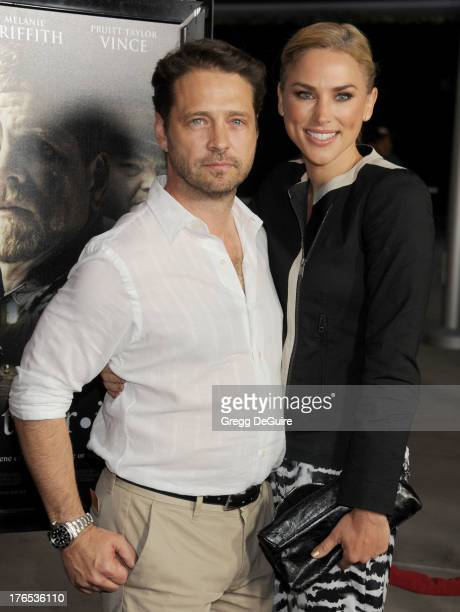 Actor Jason Priestley and wife Naomi LowdePriestley arrive at the Los Angeles premiere of Dark Tourist at ArcLight Hollywood on August 14 2013 in...
