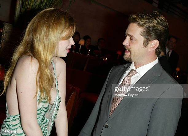 Actor Jason Priestley speaks with actress Natasha Leone as they attend the after party for the premiere of Die Mommy Die at Laura Belle's October 27...