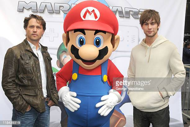 Actor Jason Priestley Super Mario and actor Chace Crawford at the launch of Mario Kart Wii at the Nintendo World on April 26 2008 in New York City
