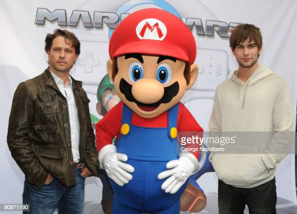 Actor Jason Priestley Super Mario and Chase Crawford at the launch of Mario Kart Wii at the Nintendo World on April 26 2008 in New York City