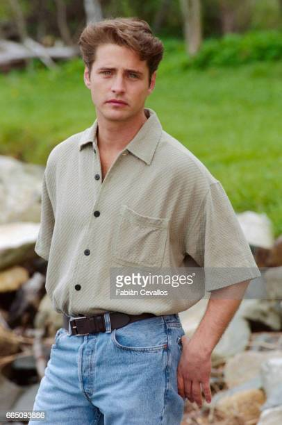 Actor Jason Priestley wearing a polo shirt and with his thumbs in the back pockets of his blue jeans on the set of the movie Life and Death on Long...