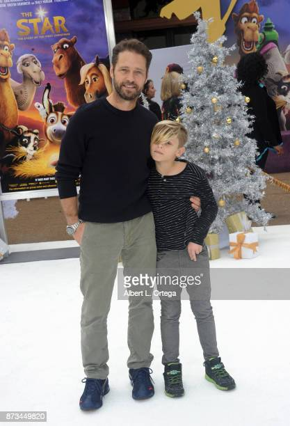 Actor Jason Priestly and son Dash Priestly arrive for the Premiere Of Columbia Pictures' 'The Star' held at Regency Village Theatre on November 12...
