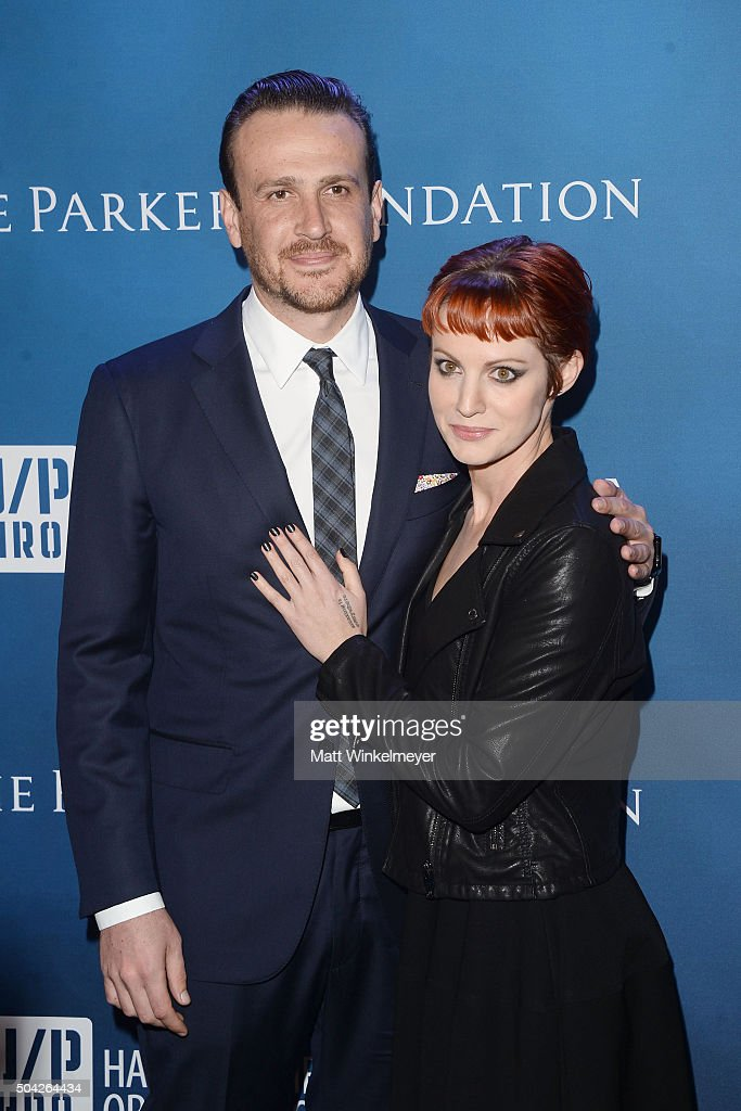 Actor Jason Segel (L) and photographer Alexis Mixter (R) arrive at the 5th Annual Sean Penn & Friends HELP HAITI HOME Gala benefiting J/P Haitian Relief Organization at Montage Hotel on January 9, 2016 in Beverly Hills, California.