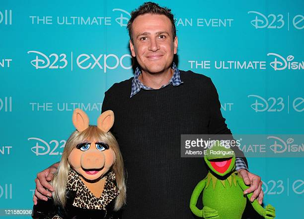 Actor Jason Segel from Walt Disney Pictures' 'The Muppets' with Miss Piggy and Kermit the Frog attend Disney's D23 Expo held at the Anaheim...