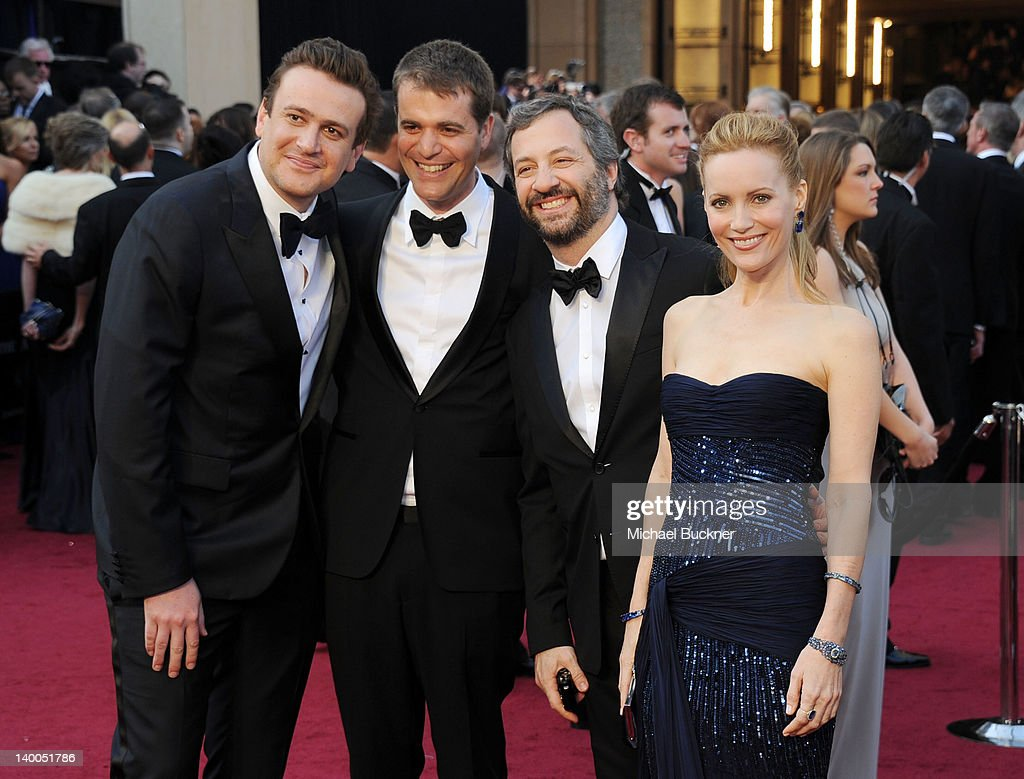 Actor Jason Segel, guest, director Judd Apatow and actress Leslie Mann arrive at the 84th Annual Academy Awards held at the Hollywood & Highland Center on February 26, 2012 in Hollywood, California.