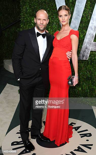 Actor Jason Statham and model Rosie HuntingtonWhiteley arrive at the 2012 Vanity Fair Oscar Party hosted by Graydon Carter at Sunset Tower on...