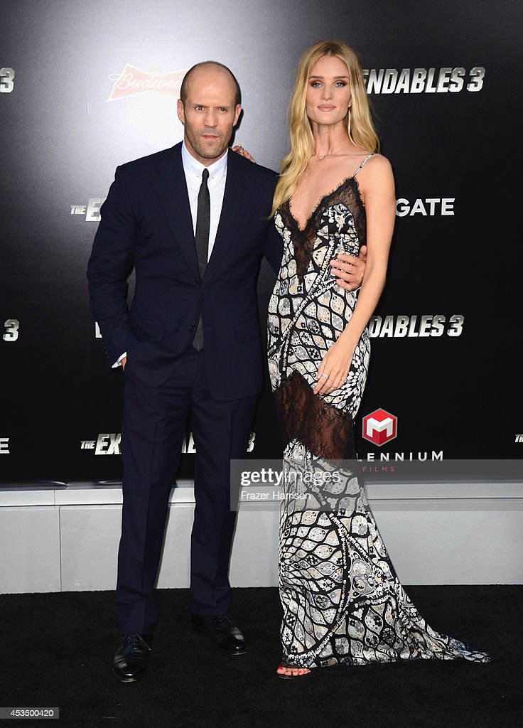 Actor Jason Statham and model Rosie Huntington-Whiteley attend Lionsgate Films' 'The Expendables 3' premiere at TCL Chinese Theatre on August 11, 2014 in Hollywood, California.