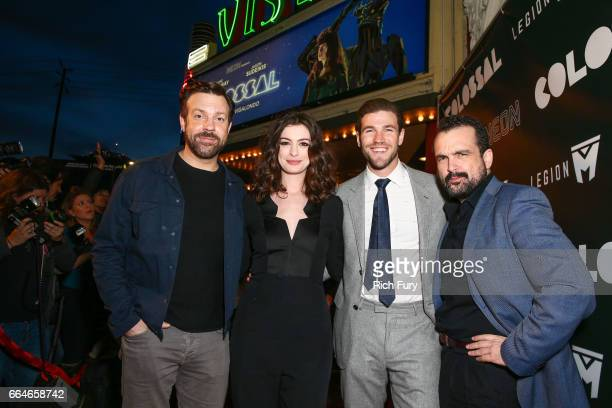 Actor Jason Sudeikis actress Anne Hathaway actor Austin Stowell and director Nacho Vigalondo arrive at the premiere of Neon's Colossal at the Vista...