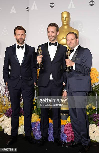 Actor Jason Sudeikis and filmakers Anders Walter and Kim Magnusson winners of Best Short Film Live Action pose in the press room during the Oscars at...