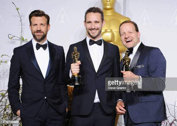 Actor Jason Sudeikis filmmaker Anders Walter and producer Kim Magnusson pose in the press room during the Oscars at Loews Hollywood Hotel on March 2...