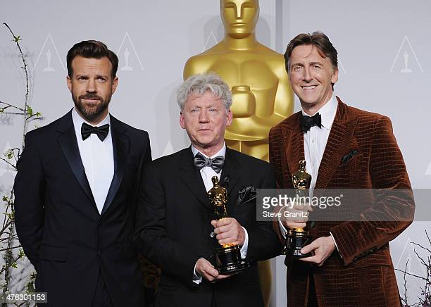 Actor Jason Sudeikis filmmaker Malcolm Clarke and filmmaker Nick Reed pose in the press room during the Oscars at Loews Hollywood Hotel on March 2...