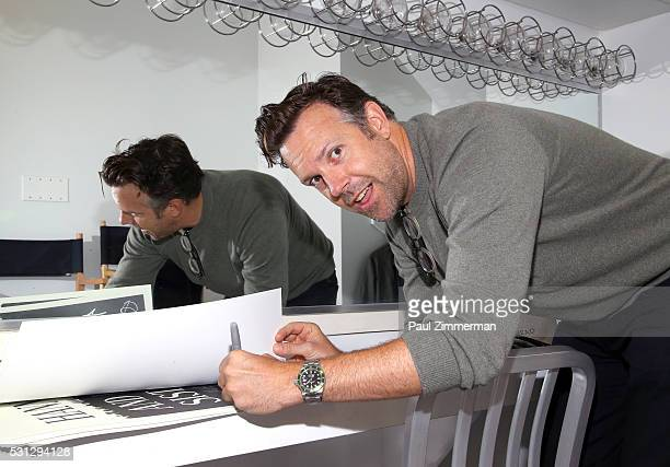 Actor Jason Sudeikis signs a poster backstage at the Film Independent Presents Live Read Of 'Hannah And Her Sisters' at Times Center on May 13 2016...