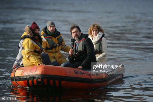 Actor Javier Bardem holding a camera arrives with workers from Greenpeace on a rubber dinghy on the Spree River in the city center for a press...