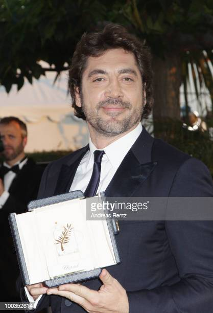 Actor Javier Bardem poses with his Best Actor award for his role in 'Biutiful'' during the Palme d'Or Award Ceremony photocall held at the Palais des...