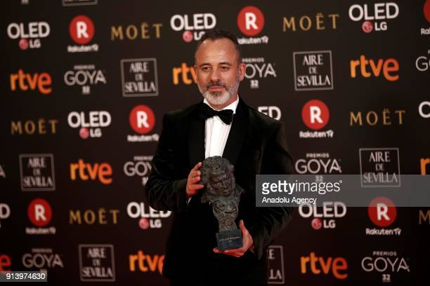 Actor Javier Gutierrez poses with his award with the movie 'El Autor' during the 32th edition of the Goya Awards ceremony in Madrid Spain on February...