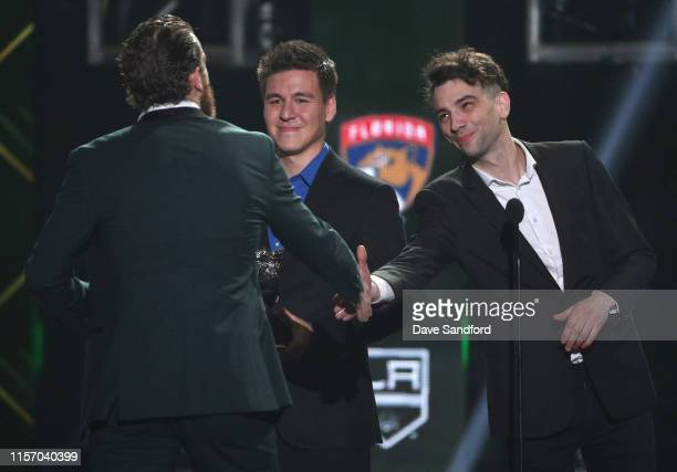 Actor Jay Baruchel and James Holzhauer present the Frank J Selke Trophy to Ryan O'Reilly of the St Louis Blues onstage during the 2019 NHL Awards at...