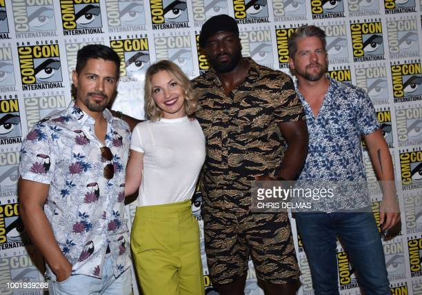 Actor Jay Hernandez Pertida Weeks Stephen Hill and Zachary Knighton arrive on the photo line for the CBS show Magnum PI at Comic Con in San Diego...