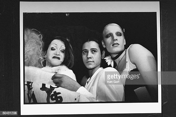 Actor Jaye Davidson clad in white suit posing w several drag queens at Fur is a Drag Party at the Heaven club