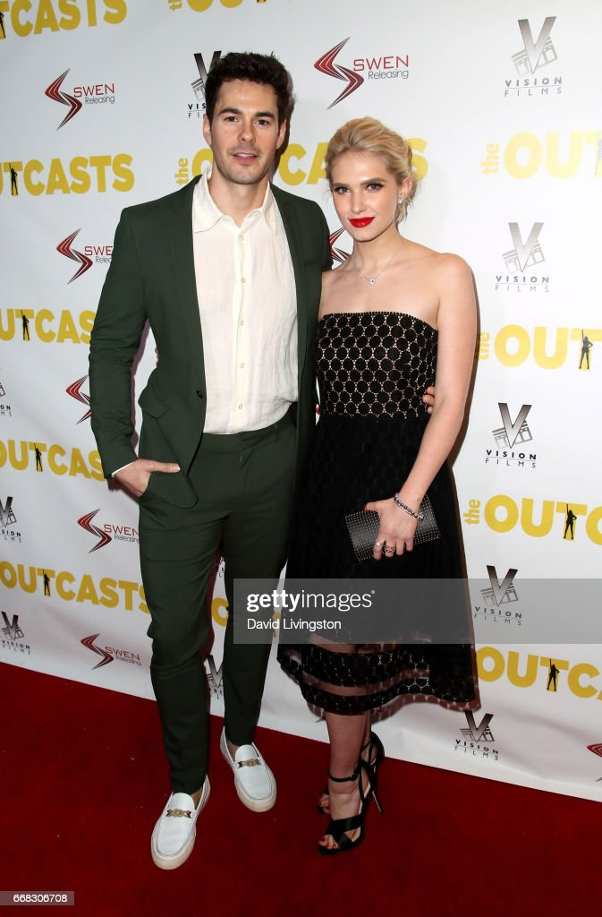 Actor Jayson Blair (L) and actress Claudia Lee attend the premiere of Swen Group's 'The Outcasts' at Landmark Regent on April 13, 2017 in Los Angeles, California.