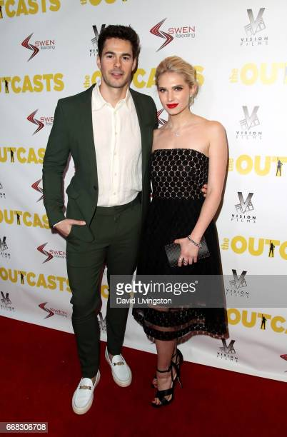 Actor Jayson Blair and actress Claudia Lee attend the premiere of Swen Group's 'The Outcasts' at Landmark Regent on April 13 2017 in Los Angeles...