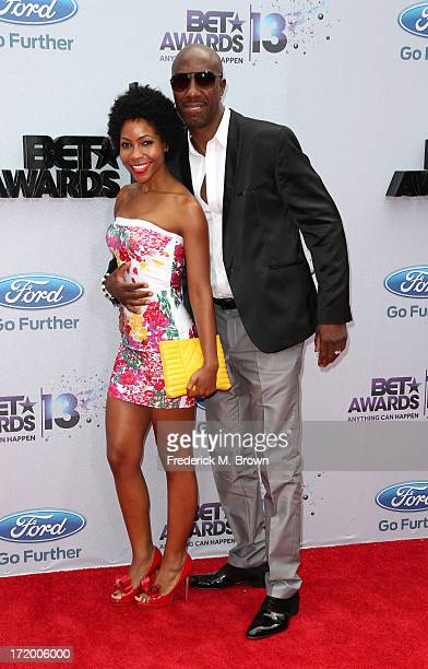 Actor JB Smoove and wife Shahidah Omar attend the 2013 BET Awards at Nokia Theatre LA Live on June 30 2013 in Los Angeles California