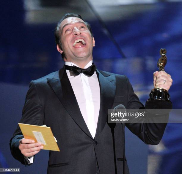Actor Jean Dujardin accepts the Best Actor Award for 'The Artist' onstage during the 84th Annual Academy Awards held at the Hollywood Highland Center...