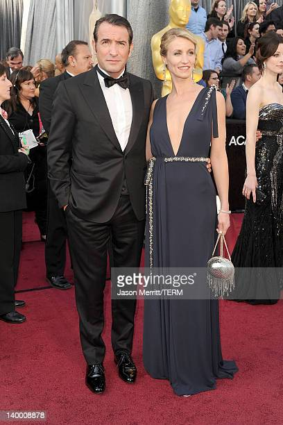 Actor Jean Dujardin and actress Alexandra Lamy arrive at the 84th Annual Academy Awards held at the Hollywood Highland Center on February 26 2012 in...